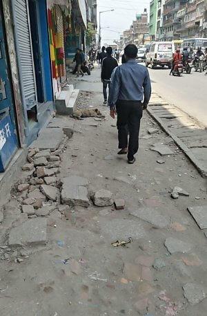 Kathmandu sidewalks require a backpack
