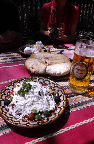 Bulgaria food prices are cheap for big portions, like a few dollars for this shopkska salad and a beer