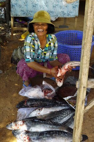 fish seller in market in Cambodia