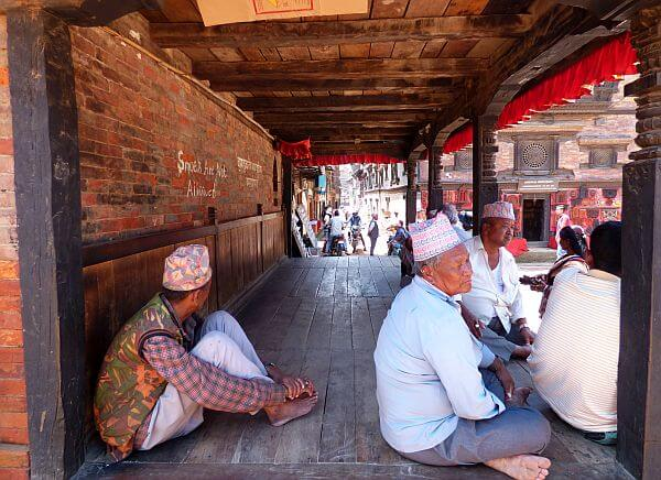 men in the shade in UNESCO Bhaktapur