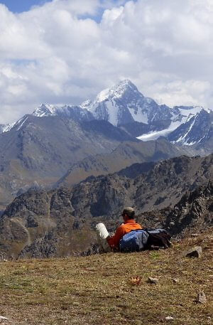 Our guide Danyar taking in the view while hiking in Kyrgyzstan, Central Asia