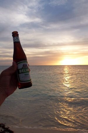 Belikin beer and another glorious sunset in Belize, on Glover's Atoll