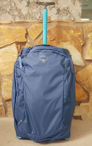Osprey Packs Ozone 26-in rolling suitcase that holds 75 liters, guaranteed for life.