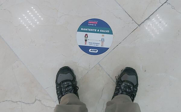 Cancun airport distancing marker on floor